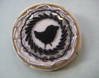 Goldwork brooch with bird