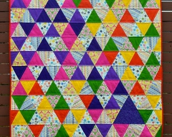 Colourful triangles lap quilt hand-made by Hug-a-Bit Quilts