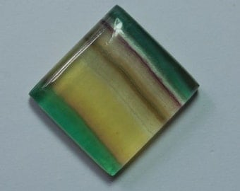 67 carat yellow banded fluorite cabochon