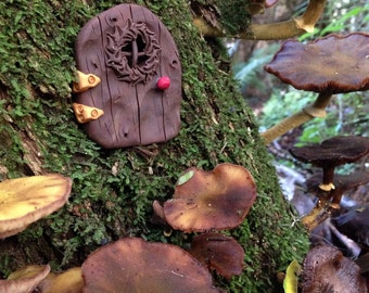 Handmade fairy door to create the perfect gateway for fairies, elves and gnomes to enter your garden.
