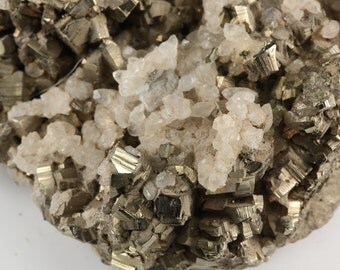 Striated Pyritohedral Pyrite Crystals covered By Fluorescent White Calcite Crystals