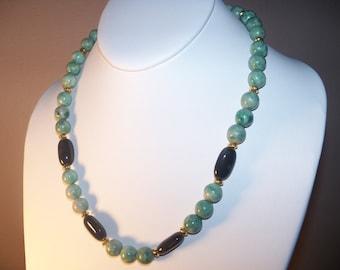 A Beautiful Qinghai Jade and Black Ceramic Necklace. (201412)