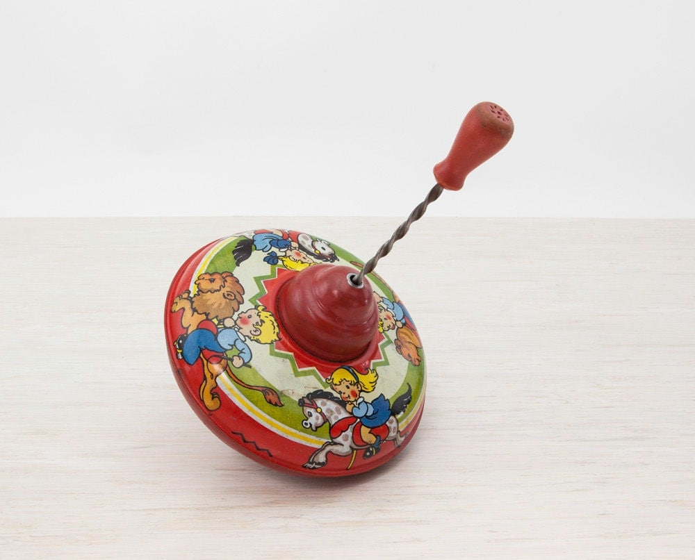 Best Antique Toys : Vintage tin toy top spinning litho