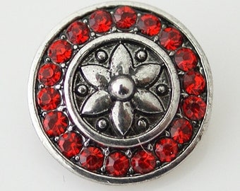 KB7420  Red Crystal Charm with a Silver Flower in the Center