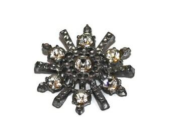Vintage Sparkly Starburst Rhinestone and Silvertone Brooch Pin