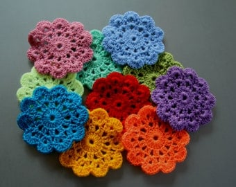 A set of 10 small knitted coasters fun colors