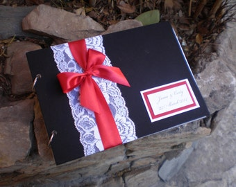 Black-red-white guest book.