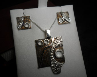 Set pendant and earrings in sterling silver