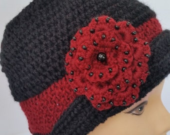 Hat in wool worked to crochet and knit with a pink beads