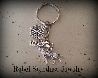 Game of Thrones Stark wolf, snowflake and Winter is Coming quote keychain
