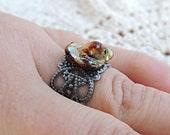 Natural Looking Polished Iridescent Ring