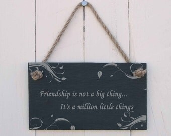 A Natural Slate Hanging Sign etched with the message 'Friendship is not a big thing... It's a million little things' (SR335)
