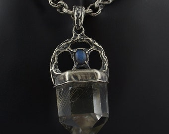 Polished quartz with small rutile and labradorite organic pendant