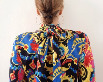 Delicious colorful vintage printed secretary blouse with a giant bow in the back,yummy!