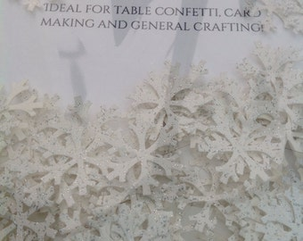 Snowflakes made from white glittered cardstock, 2cm wide. Ideal for table confetti, cardmaking and general crafting.