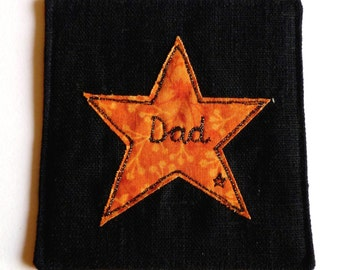 Embroidered coaster for Dad. Black linen fabric coaster with orange star design. Lovely personalised gift for a father. Ready to ship.