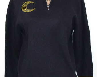 Black merino wool sweater with front zippered collar embroidered with swirly moon design
