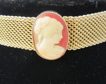 Vintage Cameo Choker- It's a classic piece from the 1960's that will look especially stunning with vintage attire. Reminder of days gone by.
