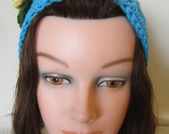 Ladies-Girls Head Wrap: The piece is made with a natural cotton aqua blue yarn & embellished with a yellow crochet flower with green leaves.