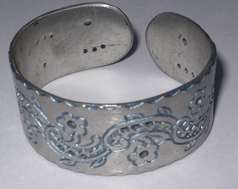 Pewter bangle from Bolivia with baby blue enamel inlay work and pierced design