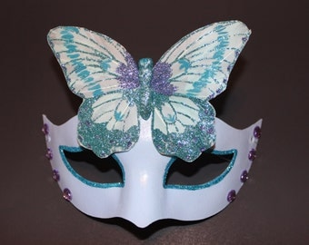 Blue glitter mask with butterfly
