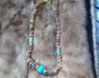 Amber necklace with blue howlit ..