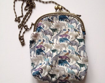 Liberty clutch bag with chain strap and kiss clasp close