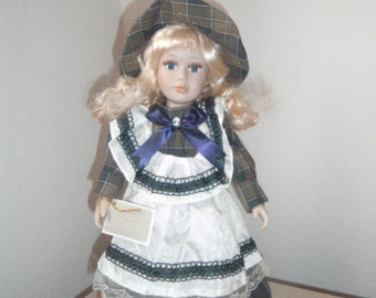 "Pretty COLLECTABLE Porcelain Doll. ""Tresors D'antan"" with Certificate of Authenticity. LIMITED EDITION."