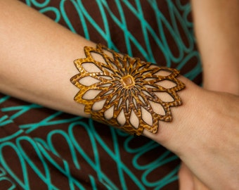 Laser cut leather bracelet cuff with geometric flower design