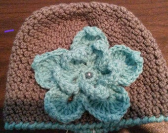 Crocheted gray bean hat with flower