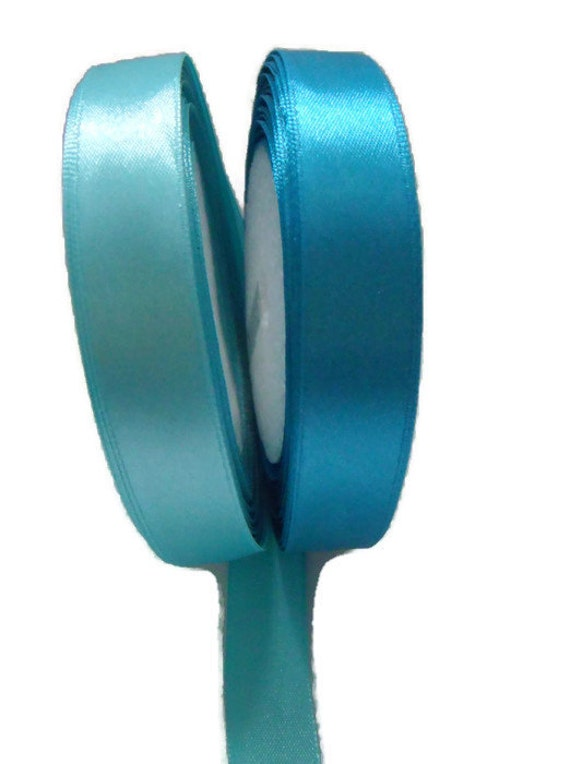 two rolls of new turquoise single sided satin ribbon, 15mm wide tape, 25m rolls on each