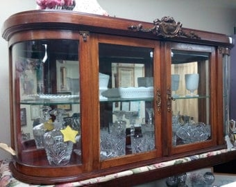 Curio cabinet, can be hung on the wall or on top of another cabinet.