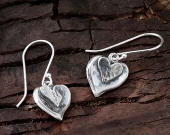 925 Sterling Silver heart dangle earrings. Textured Oxidized Silver heart shaped dangle earrings. Unique artisan design. X852