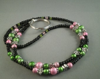 green and pink on black beaded  ID or ecig lanyard, fits most ecigs,  your choice of attachment: ecig , key or ID holder