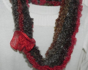 Handmade multicolored wool crocheted necklace with red flower