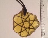 Unique glass Spirograph pendant. yellow glass, black doodle, black cord