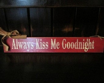 "Primitive ""Always Kiss Me Goodnight"" sign"