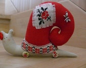 Lovely Mrs. Snail decorated by embroidery.