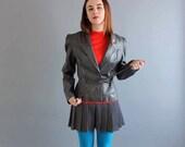 1980s leather jacket . womens vintage leather jacket . gray leather jacket with shoulder pads . womens leather jacket by Bermans