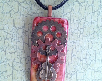 Steam Punk Alcohol Ink Dyed Domino With Multi-colored Gears and Antique Gold Acoustic Guitar on Cooper Bail and Black Organza Ribbon Choker