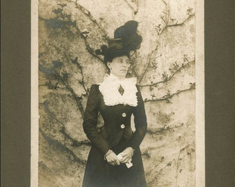 vintage photo Woman Small Waist Against Ivy Wall Holds her Gloves Cabinet Big Hat