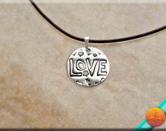 Women's Heart and Love Silver and Leather Necklace, features a Fine Silver Handmade Love Pendant, 18 inch length leather cord