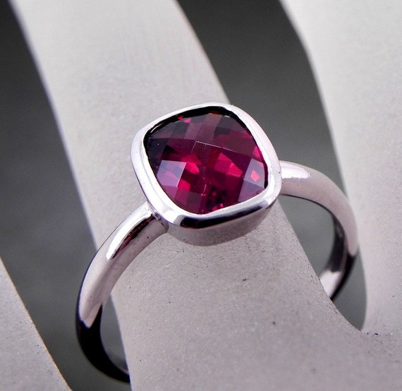 AAAA Natural Raspberry Red Rhodolite Garnet   10x8mm  3.24 Carats   in 14K white gold Bezel set  ring and available in yellow gold