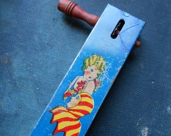 kirchoff antique vintage tin noisemaker flapper and jester antique toy party favor