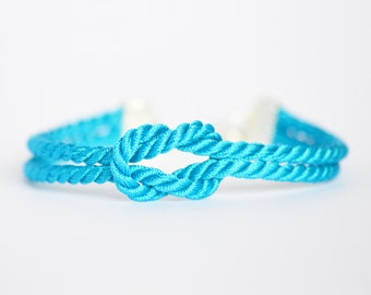 Turquoise blue forever knot nautical rope bracelet with silver anchor charm