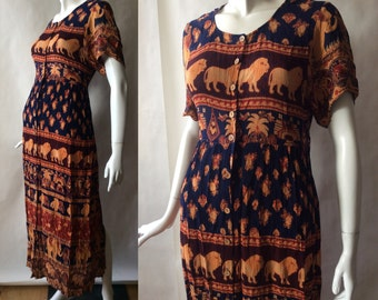 Lion, elephant, and paisley print crinkle rayon dress, in orange, navy blue, purple, brick red, and maize, early 1990's, about a medium