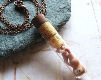 The Archeologist - Antique Glass Vial Pendant with Tiny Faux Antiquities, Wearable Handmade Curiosity