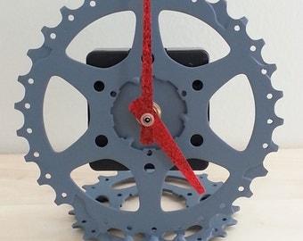 grey and red desk top bike gear clock