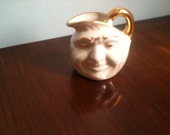 Lusterware and Gold Moon Face Toby Jug