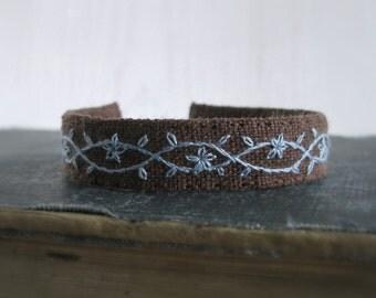 Fabric Boho Cuff Bracelet - Hand Embroidered Floral design in Light Cornflower Blue on Brown Linen - Handmade Jewelry